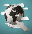 Paper Planet Earth in Hand vector image vector image