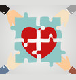 hands putting heart puzzle pieces together vector image