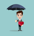the men holds the open umbrella and the heart vector image