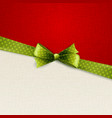 Holiday background with green polka dots bow vector image
