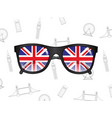sunglasses with flags of uk on the background of vector image