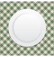 white plate on green tablecloth vector image