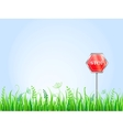 Red Stop Sign On Grass Meadow vector image vector image