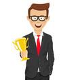 successful cute businessmanholding golden trophy vector image