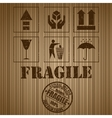 Wooden shipping box with fragile signs and stamp vector image vector image