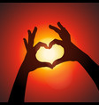 Love shape hands silhouette in sky vector image