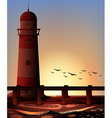Silhouette lighthouse by the ocean vector image