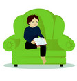boy read book on sofa vector image