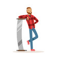 smiling lumberjack man in a red checkered shirt vector image