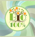 bio emblem with tree in blossom on green wavy vector image