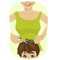 little boy getting a haircut at the barber shop vector image
