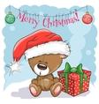 Teddy Bear in a Santa hat vector image