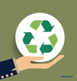 Hand with Recycle symbol symbol on the packaging vector image