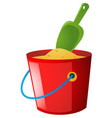 bucket of sand and green spoon vector image