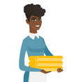 african housekeeping maid with stack of linen vector image vector image