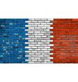 Grunge flag of France on a brick wall vector image