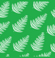 fern branch on green - seamless doodle pattern vector image