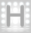 H over lighted background vector
