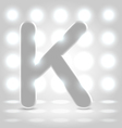 K over lighted background vector