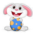 easter cute bunny holds egg vector image