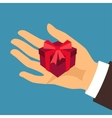 Postcard man hand holding a gift box vector image