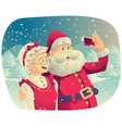 Santa Claus and Mrs Claus Taking a Photo Together vector image