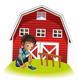 A sad boy in front of the barnhouse vector image vector image