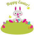 Easter bunny and colored eggs in the grass vector image