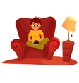 boy sitting on the armchair and playing tablet vector image