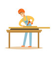 young carpenter man drilling wood in his workshop vector image