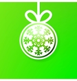 Christmas ball cutted from paper on green EPS8 vector image
