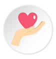 hand holding a pink heart icon circle vector image