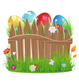 Easter eggs with grass and fence vector image
