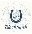 horseshoe and vintage sun burst frame Blacksmith vector image