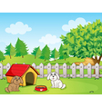 A doghouse inside the wooden fence near the hill vector image vector image