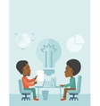 Two african businessmen sitting working together vector image