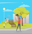 boy uses his smartphone during walk in city park vector image