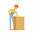 young smiling carpenter man building chest of vector image
