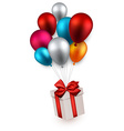 Gift box on colorful balloons vector image