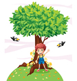 A young boy standing under a big tree with two vector image