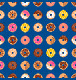 Doodle donuts pattern on blue background vector image