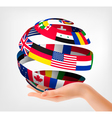Flags of the world on a globe held in hand vector image vector image