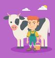 little caucasian farmer boy milking a cow vector image