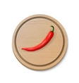realistic red hot chili pepper icon on a round vector image
