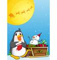 A penguin near the sleigh with a snowman vector image vector image