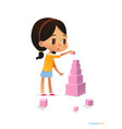 girl with dark hair stands and builds tall pyramid vector image