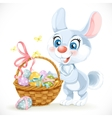 Cute Easter Bunny with a basket of eggs vector image