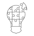 lightbulb in puzzle pieces icon vector image