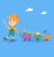 boy pushing a cart with plants and garden tools vector image