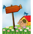 A puppy and the wooden arrow vector image